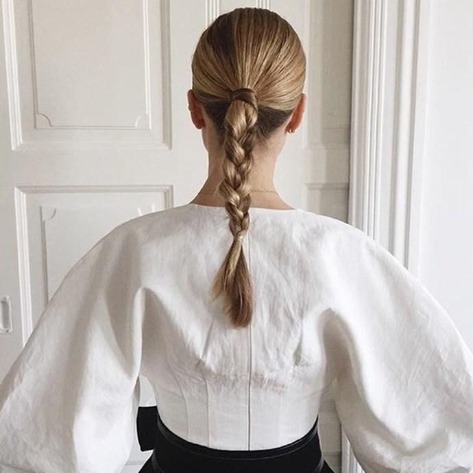 "Street styler Pernille tries out a pretty plait. <br><br> <a href=""http://www.instagram.com/pernilleteisbaek"">@pernilleteisbaek</a>"