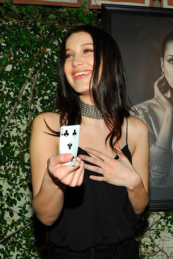 Bella Hadid with a playing card.