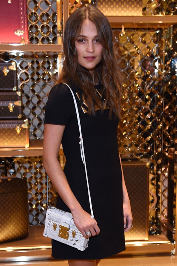 Alicia Vikander attends the Louis Vuitton Pre-BAFTA party, February 2016