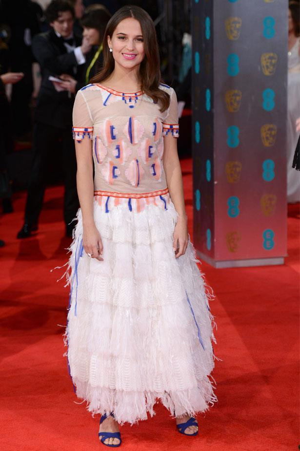 Alicia Vikander attends the BAFTAS, February 2014