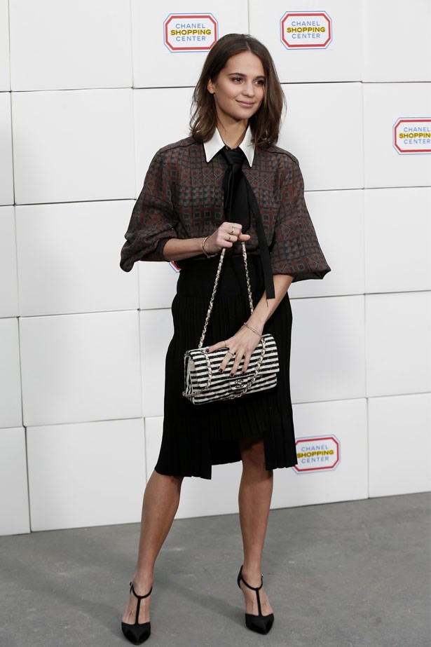Alicia Vikander attends the Chanel AW14/15 show in Paris, February 2014