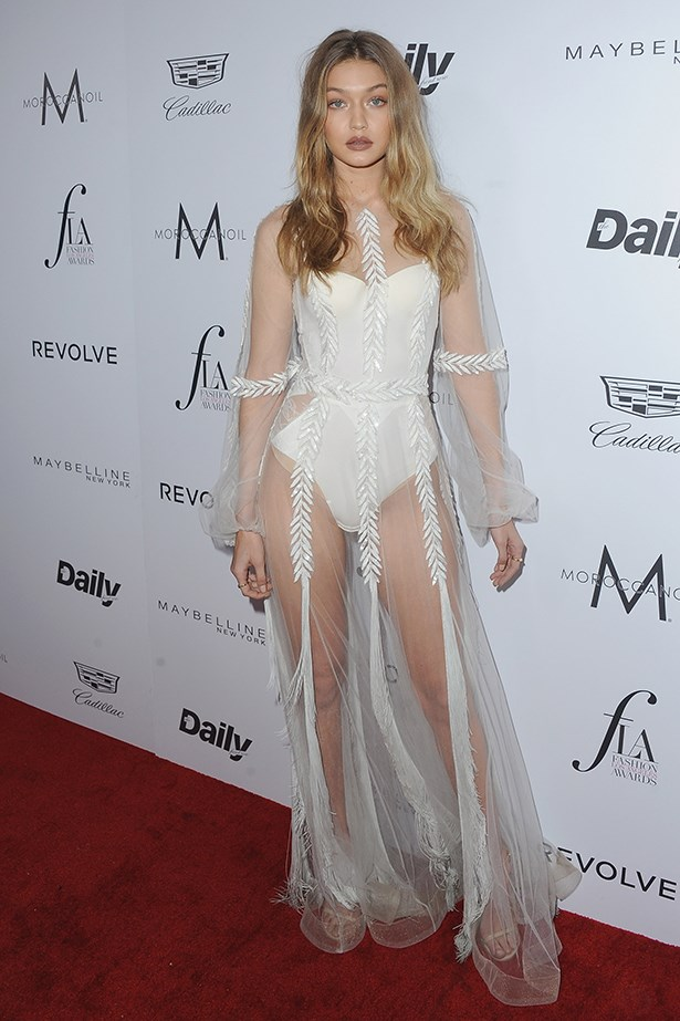 Gigi Hadid isn't too shy to wear the naked dress. She wore this sheer white Yanina Couture dress over a white bodysuit at the Fashion Los Angeles Awards.