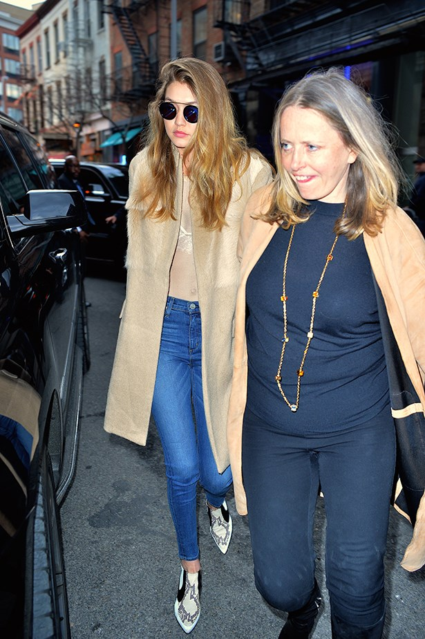 Gigi paired her sheer white top with a lace bra, blue jeans and pointed boots in New York.