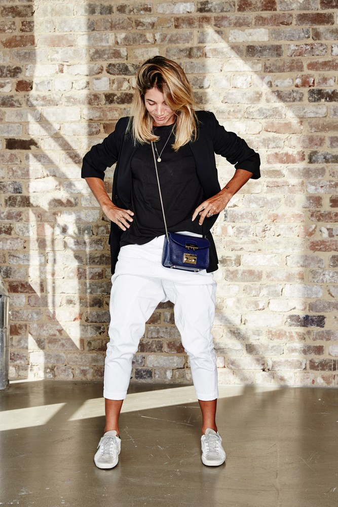 "<strong>Carly Roberts, creative director</strong><br> <em>Drop-crotch white denim jeans by Bassike</em><br> ""I have these jeans in three different washes—they're comfortable, work for any occasion and suit my minimalist style. Drop crotch, please never go out of fashion!"""