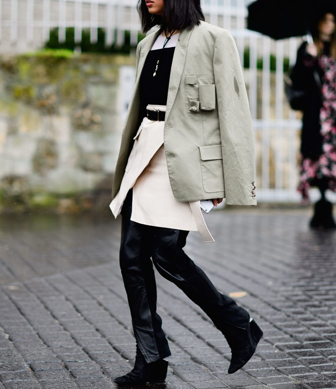 Instead of black tights, reach for a pair of slim-cut leather pants to pair with your polished dresses when it's cold out. A dress and black tights can seem a little stiff and cocktail-party-ready, while a dress over pants skews more laid-back and street style-y.