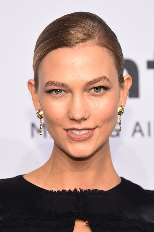 2016, Kloss dons a nude lip and brushed up brows at the <em>amFAR New York Gala. </em>