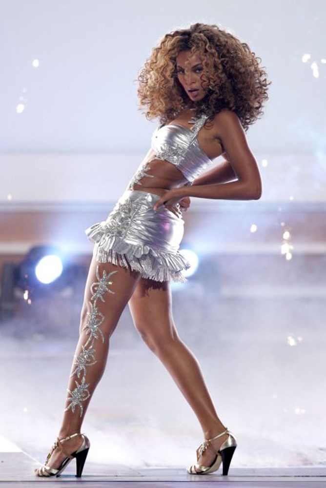 I like to call this Beyoncé's Tina Turner phase, when she's never not wearing a frilly mini skirt with a matching top. Her 2006 BET Music Awards look tops the list with this embellished leg moment.