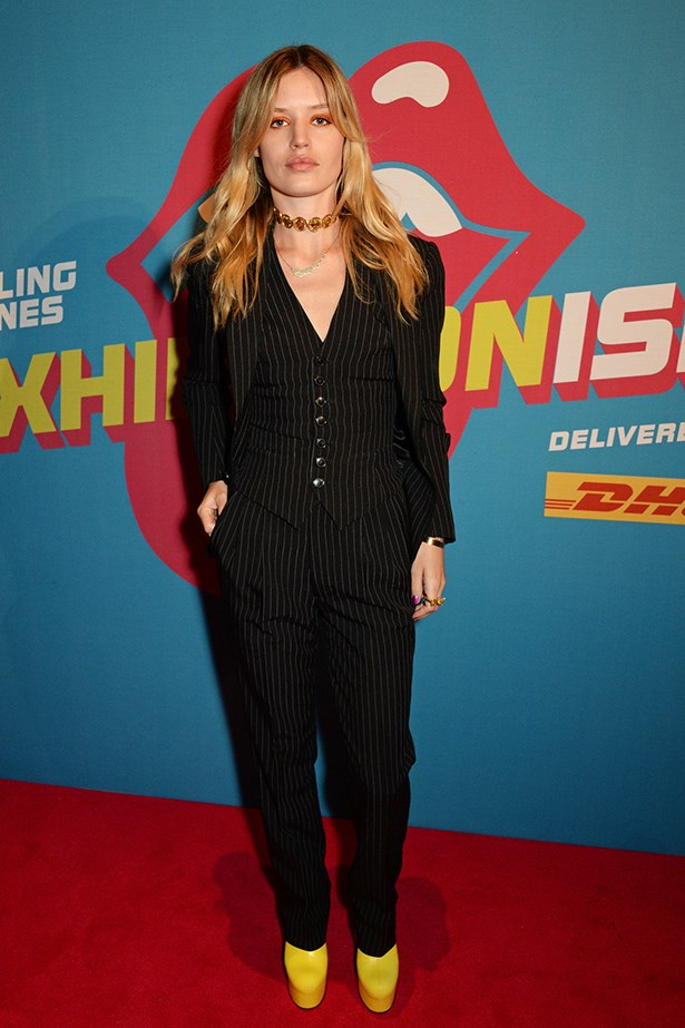 "Georgia May supported her dad Mick Jagger at the opening of his ""Exhibitionism"" showing at Saatchi Gallery by looking way, way better than him in a pinstripe three-piece suit, yellow platforms and unexpected orange eyeshadow."