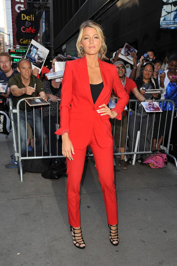 Blake Lively paired her red suit with a black tank and lace up shoes.