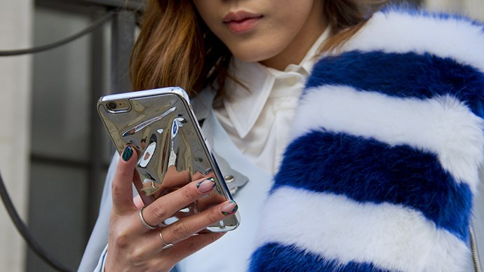 Street style woman on iPhone.