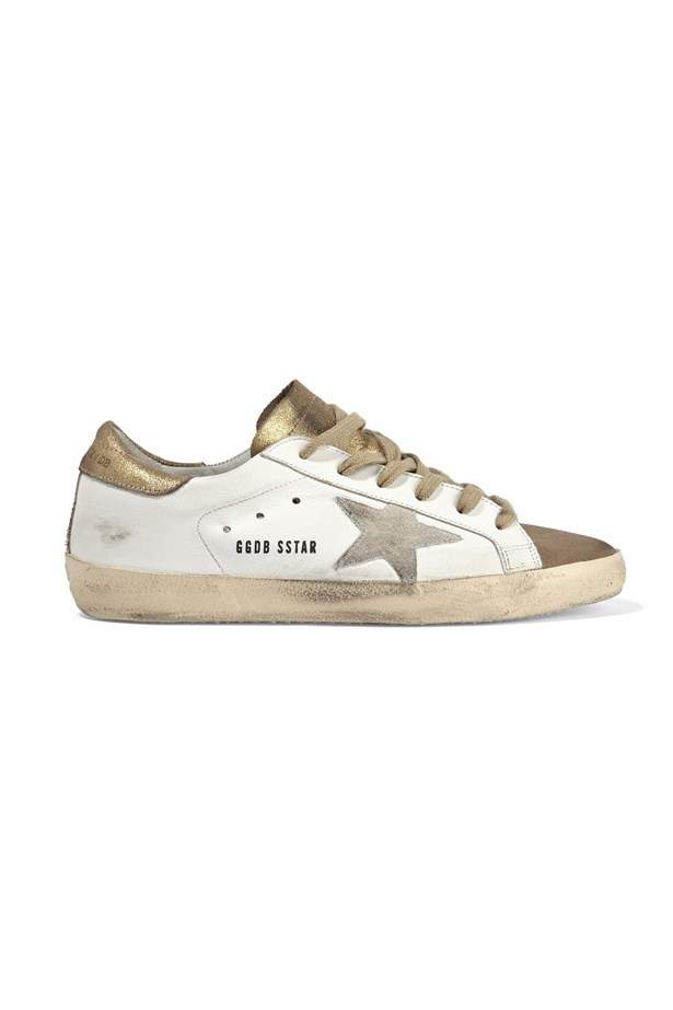 """<a href=""""https://www.net-a-porter.com/au/en/product/643018/Golden_Goose_Deluxe_Brand/super-star-distressed-glittered-leather-sneakers"""">Super Star leather sneakers, $443, Golden goose deluxe brand at net-a-porter.com</a>"""