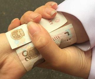 Chinese women wrap bank notes around their wrists to prove they're skinny in strange new fitness fad