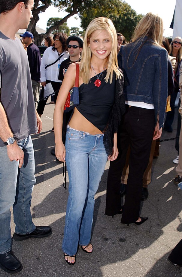 Sarah Michelle Gellar is seen here demonstrating the chic way to do raw-edge flares and a side-tie one-shouldered scarf top.