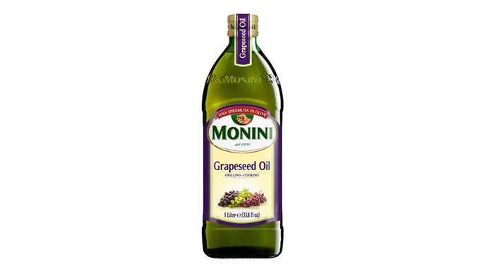 """<p> <strong>Grapeseed oil</strong><p> <p> Grapeseed oil is typically extracted from the seeds of wine grapes, and while it's super sad that those particular grapes missed out on the opportunity to be made into wine, the resulting product can be used to treat acne, tighten skin, brighten dark circles, and make an effective night serum, so it's not all bad. You can mix a few drops in with your regular moisturiser to help your skin retain more of the moisture you're putting into it, massage it into the skin on its own, or dab it onto under-eye circles. (<a href=""""http://shop.coles.com.au/online/national/monini-grape-seed-oil-1702069p"""">Monini Grapeseel oil</a>, $14)"""