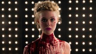 Elle Fanning plays a murderous model alongside Abbey Lee Kershaw, Keanu Reeves, Christina Hendricks, and Jenna Malone in Nicholas Winding Refn's The Neon Demon