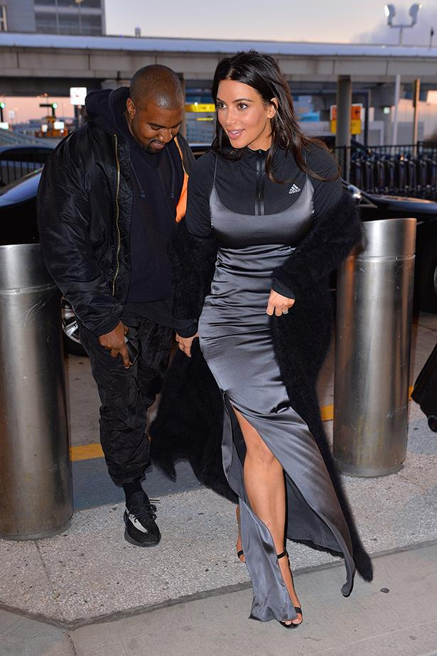 For a recent airport sighting, Kim turned heads by pairing this grey-blue slip dress with... a tracksuit jacket underneath?