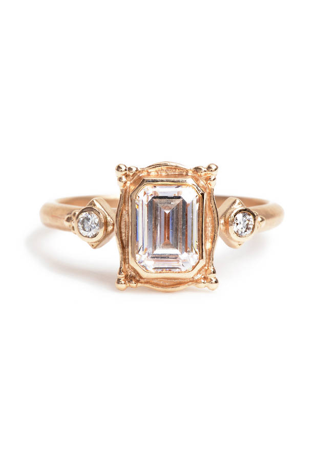 """<a href=""""http://www.greenwichjewelers.com/shop/category/engagement-rings/products/megan-thorne-emerald-cut-picture-frame-ring-in-rose-gold#"""">Megan Thorne Picture Frame Ring in Rose Gold</a>, <em>price on request</em>."""