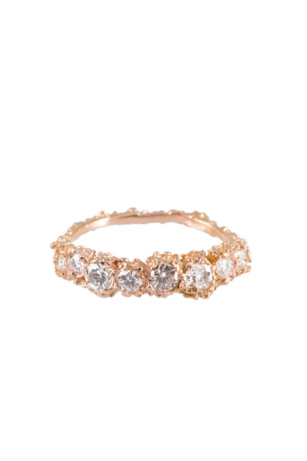 "<a href=""http://www.michelle-oh.com/collections/wedding-edit/products/anemone-p-rose-gold-half-eternity-ring-p"">Michelle Oh Anemone Rose Gold Half Eternity Ring</a>, $1,590 AUD."