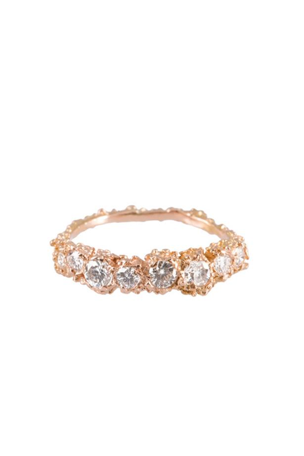 """<a href=""""http://www.michelle-oh.com/collections/wedding-edit/products/anemone-p-rose-gold-half-eternity-ring-p"""">Michelle Oh Anemone Rose Gold Half Eternity Ring</a>, $1,590 AUD."""