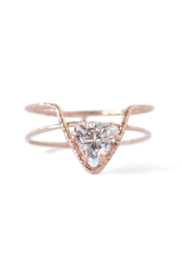 "<a href=""http://www.nataliemariejewellery.com/collections/rings/products/offset-triangle-ring-with-crown"">Natalie Marie Offset Triangle Ring with Crown</a>, $390 AUD."
