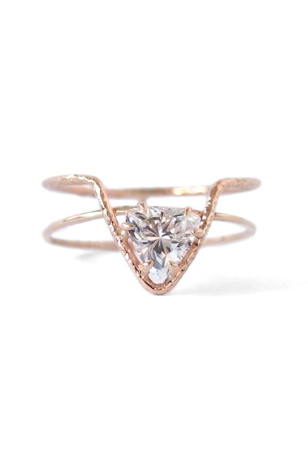 """<a href=""""http://www.nataliemariejewellery.com/collections/rings/products/offset-triangle-ring-with-crown"""">Natalie Marie Offset Triangle Ring with Crown</a>, $390 AUD."""