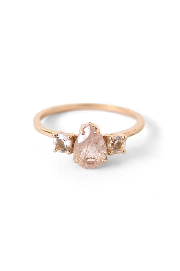 """<a href=""""http://www.nataliemariejewellery.com/collections/rings/products/precious-pear-trio-ting?variant=14407196484"""">Natalie Marie Precious Pear Trio Ring</a>, $1,340 AUD."""