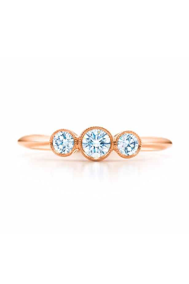 """<a href=""""http://www.tiffany.com.au/jewelry/rings/three-stone-milgrain-ring-GRP05481?fromGrid=1&search_params=p+1-n+10000-c+287466-s+5-r+-t+-ni+1-x+-lr+-hr+-ri+-mi+-pp+12100+22&search=0&origin=browse&searchkeyword=&trackpdp=bg&fromcid=287466#p+1-n+10000-c+287466-s+5-r+-t+-ni+1-x+-pu+-f+false+1-lr+-hr+-ri+-mi+-pp+12100%2B22"""">Tiffany & Co Three Stone Milgrain Ring</a>, $4,750 AUD."""
