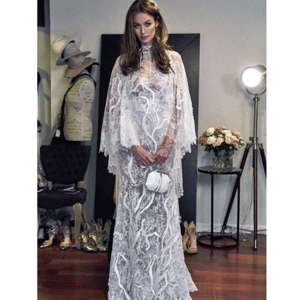 "<p> Nicole's reception dress was designed by YolanCris.<p> <p> Image via <a href=""https://www.instagram.com/yolancris/?hl=en"">YolanCris Instagram</a>."