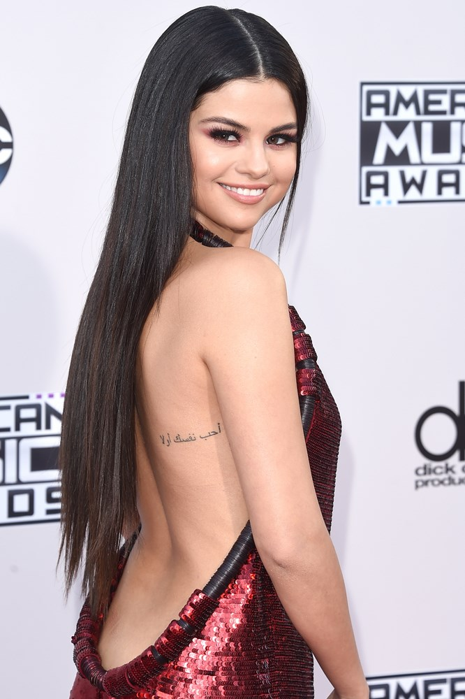 Selena Gomez back tattoo