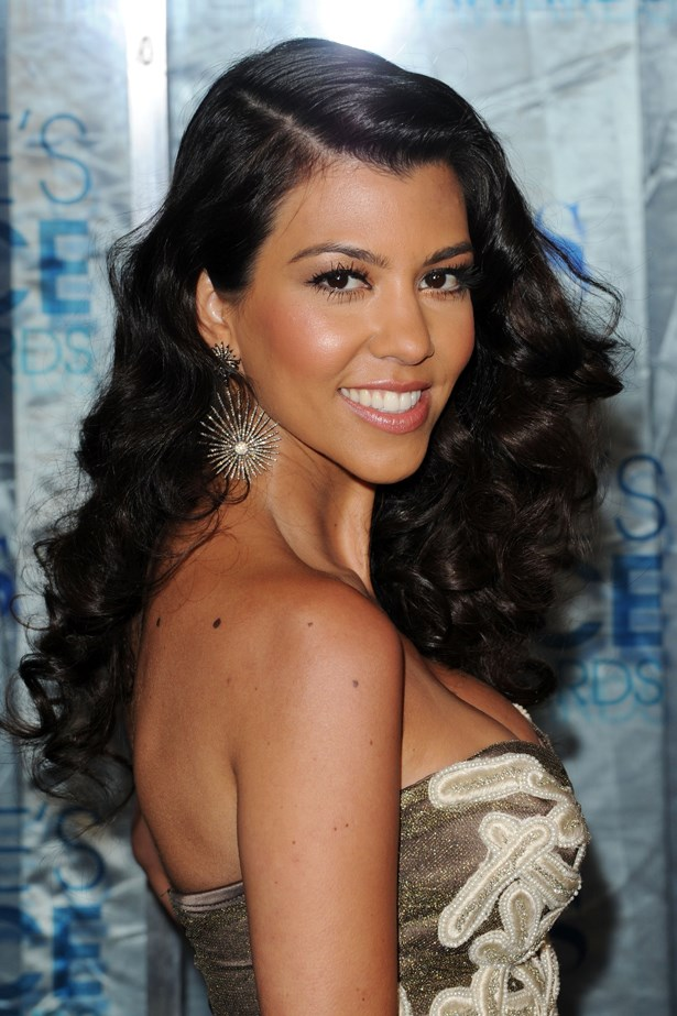 2011, Kourtney shows off voluminous curls and a glowing complexion at the <em>People's Choice Awards.</em>