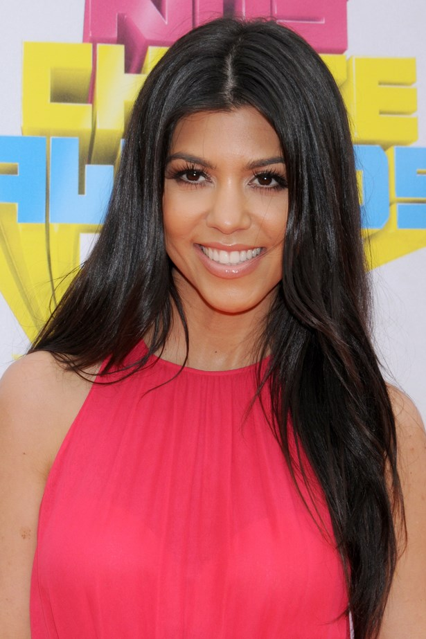 2011, Kourtney dons tousled tresses and a sweep of winged liner at the <em>Kids' Choice Awards.</em>