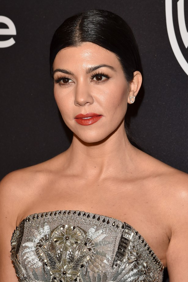 2016, Kourtney channels Old Hollywood Glamour with a red lip and a centre-parted chignon at the <em>InStyle and Warner Bros. 73rd Annual Golden Globe Awards Post Party.</em>