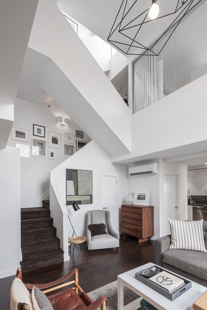 Occupying the top two floors of an eight-storey building, the apartment boasts 18-foot ceilings and custom fixtures.
