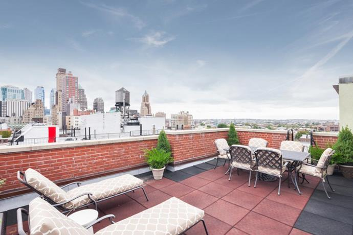 There's a private roof deck overlooking the New York City skyline and a separate outdoor space measures more than 150 square metres – bigger than most New York City studio apartments.