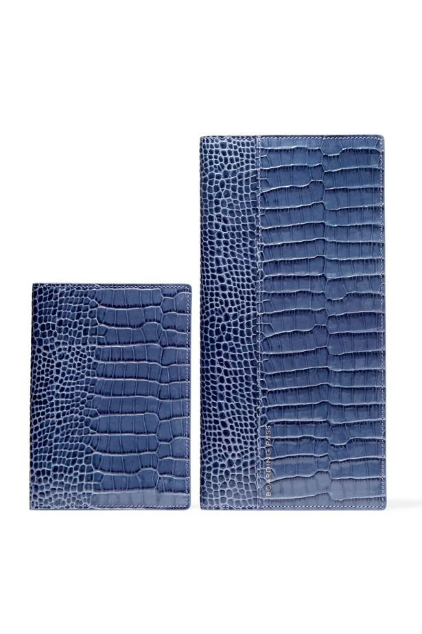 "<a href=""https://www.net-a-porter.com/au/en/product/648439/smythson/croc-effect-glossed-leather-travel-wallet-and-passport-cover"">Smythson Croc-effect glossed-leather travel wallet and passport cover</a>, $650."