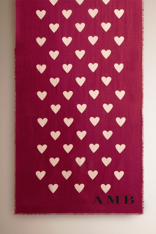 """<a href=""""https://au.burberry.com/the-lightweight-cashmere-scarf-in-heart-print-p39941971"""">Burberry Lightweight cashmere scarf in heart print</a>, $1,395."""