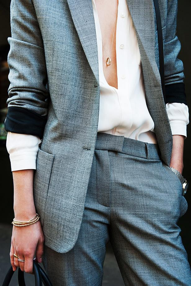 """How to make masculine dressing sexy: the perfect suit, a hint of décolltage, sleeves casually pushed up and feminine jewellery. Snap."""
