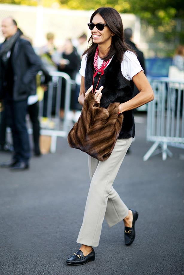 """This Italian-style androgynous dressing made her own, with a bright scarf and furry bag adding personality to forever pieces like loafers, chinos and a white tee."""