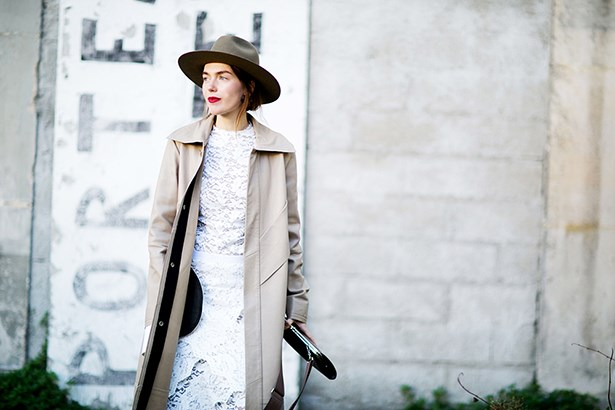 """This look seems semi-slapdash but it's anything but. Note how the oversized coat and perfectly hat add a slouchy nonchalance to her pretty lace dress, It's the details that count, especially that contrasting red lip."""