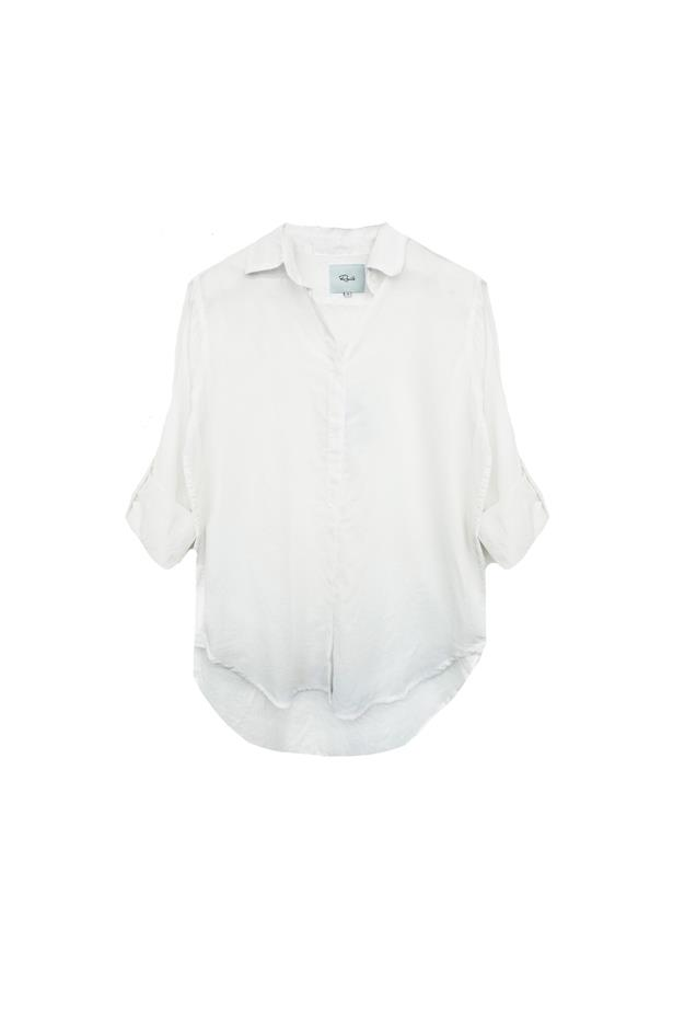 """Shirt, $187, <a href=""""http://www.railsclothing.com/collections/women/products/ella-white"""">Rails</a>."""