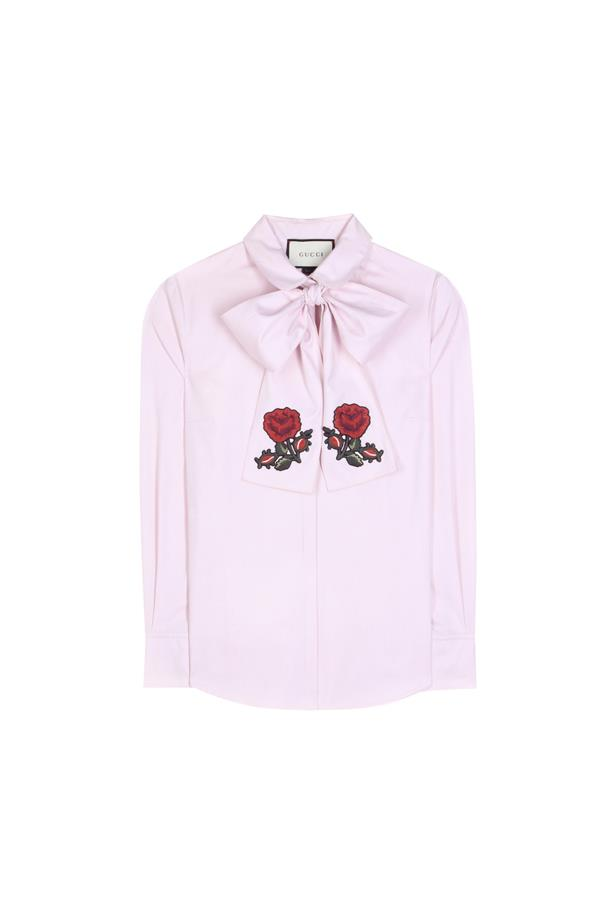 "Shirt, $1,223, <a href=""http://www.mytheresa.com/en-de/pussy-bow-cotton-blouse-590181.html"">Gucci</a>."