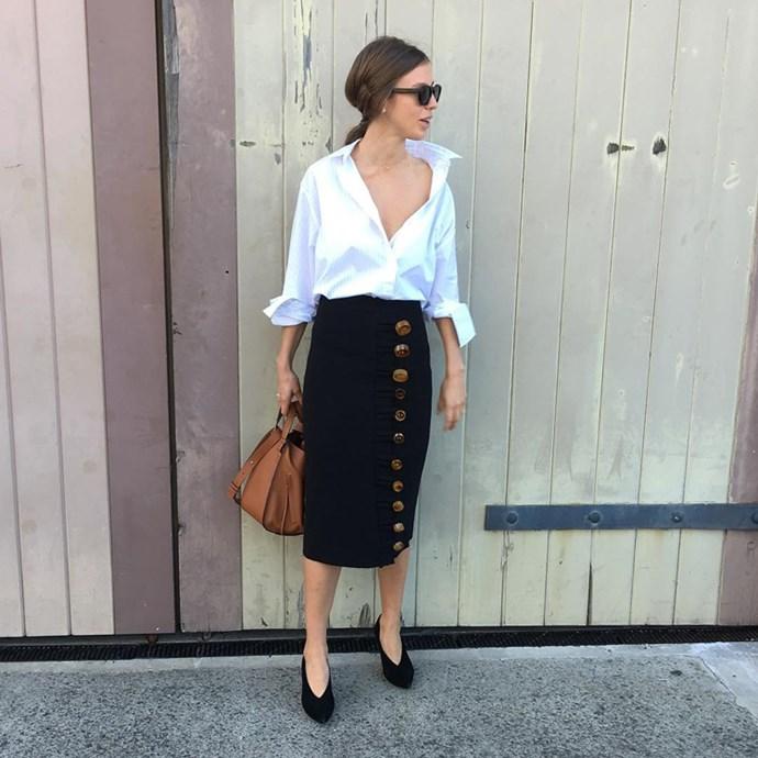 "Fashion editor Emma Kalfus (<a href=""https://www.instagram.com/emma_kalfus/"">@emma_kalfus</a>) in an IRO shirt, Christopher Esber skirt, Céline shoes and Loewe bag."