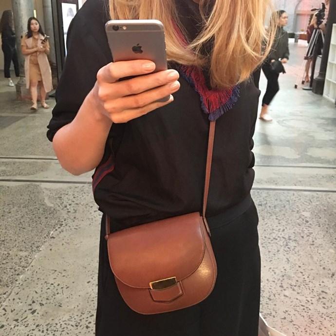"Associate editor Genevra Leek (<a href=""https://www.instagram.com/genevra_leek/"">@genevra_leek</a>) in an Albus Lumen top, Maison Margiela pants and Céline bag."