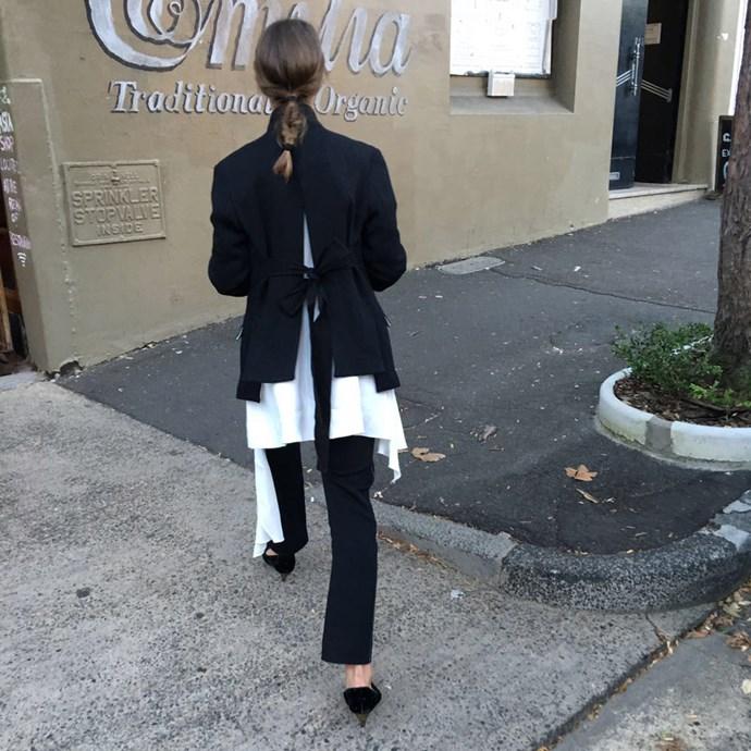 "Fashion editor Emma Kalfus (<a href=""https://www.instagram.com/emma_kalfus/"">@emma_kalfus</a>) wears Bassike jacket and pants, AltewaiSaome tunic and Saint Laurent heels."