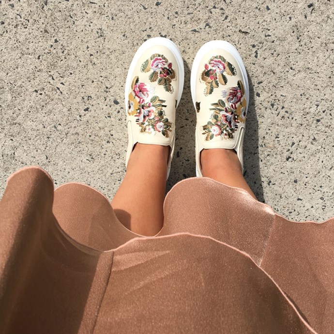 "Bookings and style editor Dannielle Cartisano (<a href=""http://www.instagram.com/danni_cartisano"">@danni_cartisano</a>) wearing an Ellery skirt and Alexander McQueen slip-on sneakers."