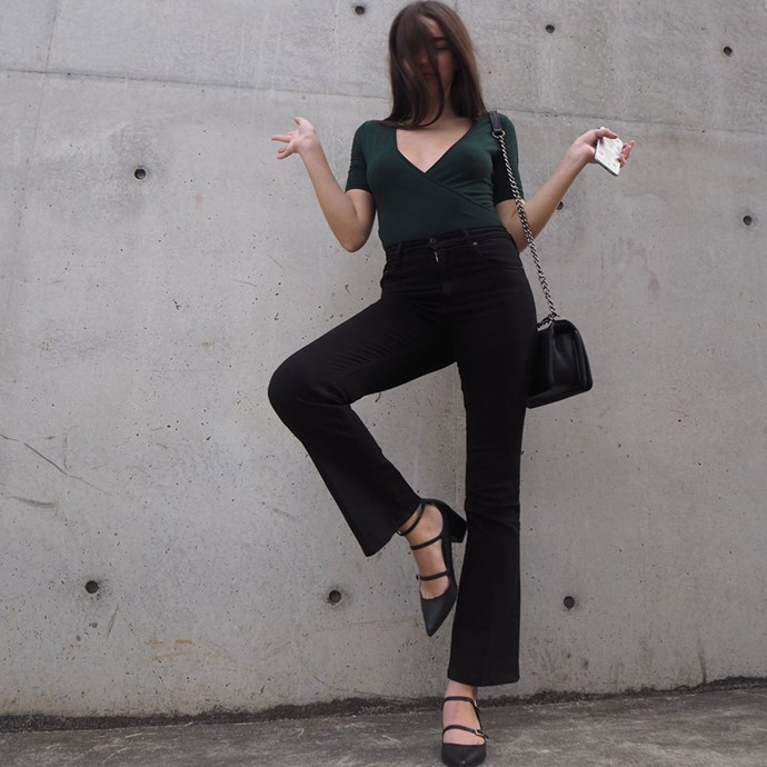 """<strong>Day four</strong><br><br>My Wednesday outfit: I'm wearing Nobody Denim kick flare jeans and a Sir The Label top with my Chanel 'Boy' bag. I call this pose """"The Flamingo."""""""