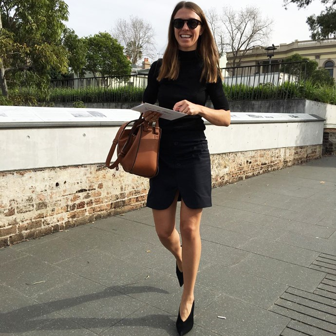 Fashion editor Emma Kalfus wears a H&M top, Jacquemus skirt from My Chameleon, Loewe bag and Céline shoes and sunglasses.