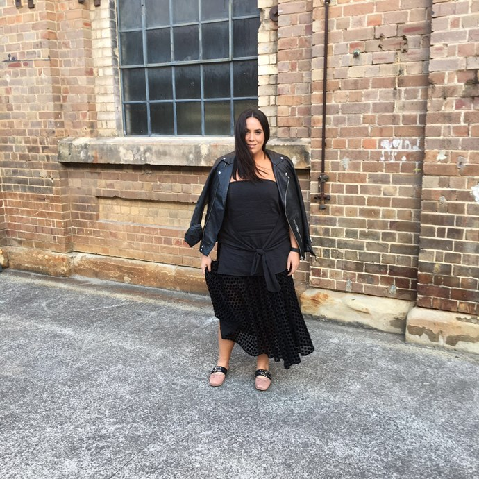 Bookings and style editor Dannielle Cartisano wears top by Kitx, skirt by Camilla and Marc, ballet flats by Miu Miu and leather jacket by AllSaints.