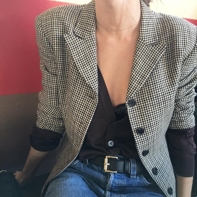 Fashion editor Emma Kalfus in a Gucci top, Levi's jeans, Michael Kors belt and vintage blazer.