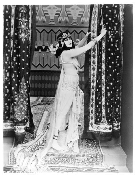 """<p><strong>THEDA BARA, 1917</strong><p><p> The actress Theda Bara — one of Hollywood's first ever sex symbols and femme fatales — starred in the title role of the 1917 silent film Cleopatra, wearing expensive and racy costumes that included a coiled snake bra that wrapped around her bare breasts. Censors required cuts of scenes that included Bara's """"objectionable costume"""" and """"costume exposing body."""" Sadly, most of the film is now lost because the last remaining prints were destroyed."""